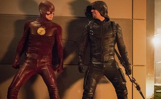 """The Flash -- """"Invasion!"""" -- Image FLA308c_0466.jpg -- Pictured (L-R) Grant Gustin as The Flash, Stephen Amell as Green Arrow and David Ramsey as John Diggle -- Photo: Dean Buscher/The CW -- © 2016 The CW Network, LLC. All rights reserved"""